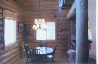 Polson house photo - Log Home Dining Area also has 4 Seat Breakfast Bar