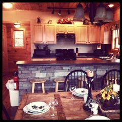 Sevierville chalet photo - looking from the dining room to the kitchen - fully furnished for the cooks!
