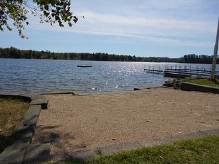 Lake Winnisquam house photo - Sandy beach, Swim Raft, and two docks with ample space for boats,