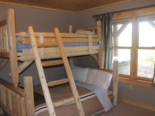 Newry house photo - Bunk with a full bottom and twin top. 2 lower level bedrooms w/same bed set up.