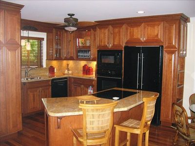 Kitchen with Cherry Wood Cabinets and Granite Counters
