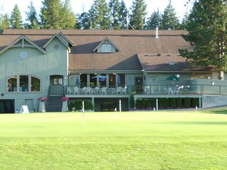 Twin Lakes condo photo - View of the clubhouse and practice green.