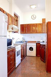 Charming kitchen that is fully furnished. Stove, microwave, fridge/freezer