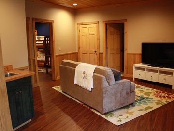 "Lower Level Living Room - Includes 50"" Flat Screen TV/Blu-Ray/DVD with wet bar"