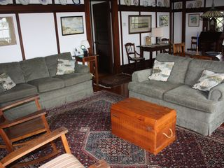 Chatham house photo - The Point has a large arts and craft style living room on the bay side.