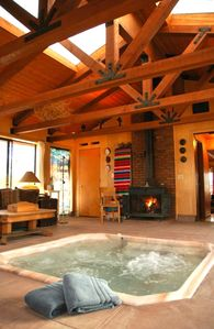 End the day with a hot mineral spa next to a warm fire and blissful waterfall