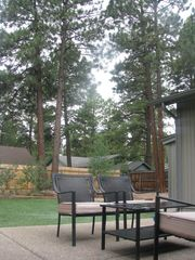Flagstaff house photo - Outdoor patio with two sitting areas. This is one of them. Gas grill available.