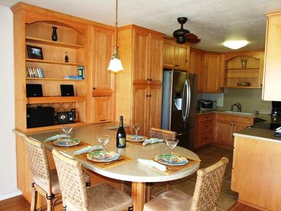 Dining bar and kitchen - beautiful cabinets & stainless steel appliances.