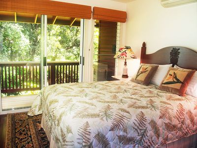 Riverhouse: One of the other bedrooms looks over the river with a private deck.