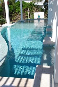 50-ft pool with shady & sunny and shallow & deep sections