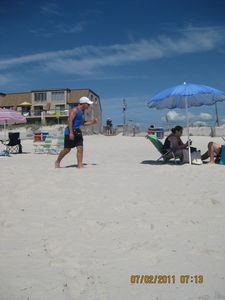 White sand beach with condo in the background