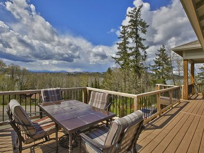 MAIN FLOOR DECK WITH LIMITED VIEWS AND A GREAT PLACE FOR ENTERTAINING