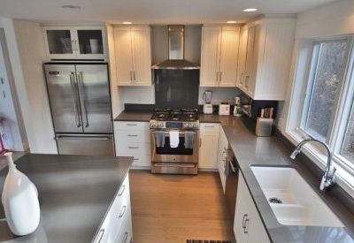 Well-Equipped Chef Kitchen Has Commercial Stainless Appliances