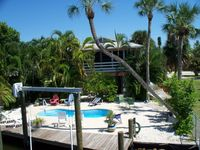 Tropical, Beachy Decor,HTD Pool, Dock, Beach, Walk to Everything!