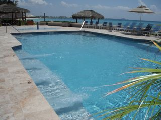 Grand Cayman condo photo - Big oceanside pool with massage jet and sitting benches