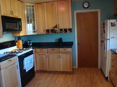 Kitchen has Pergo floors, hickory cabinets & many gadgets to make cooking easy.