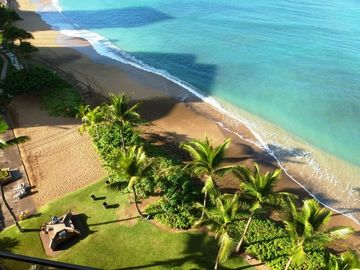 Looking down from the main floor lanai. Beautiful beach with volleyball court