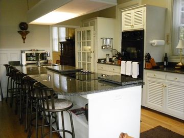 Granite bar for six in fully equipped kitchen, w/ French doors to a HUGE deck!!