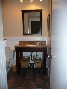 Guest bath vanity.  Lovely cottage feel.  Open and updated throughout.