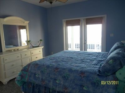Periwinkle star fish room with king size bed, private bath and balcony.