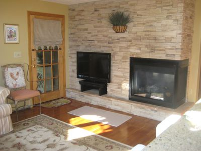 "Living Room with 42"" HDTV and Gas Fireplace."
