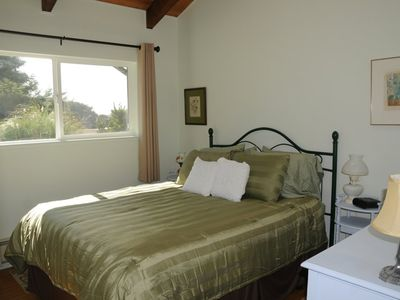 Mid bedroom, with queen size bed and sky light