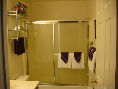 Upstairs full bath with extra towels stored in bath cabinet
