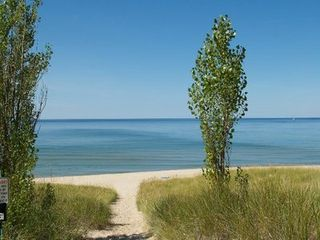 Onekama condo photo - Walk right out to the sandy Lake Michigan beach!