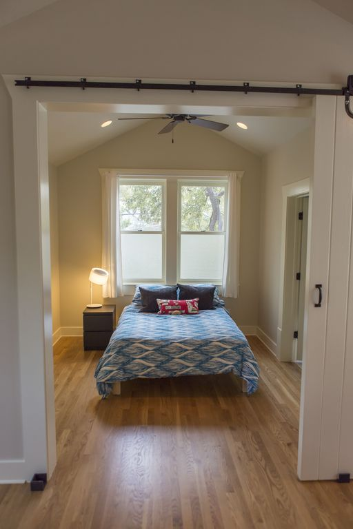 Bedroom w/ double bed. Walk in closet and bathroom are located off this room.