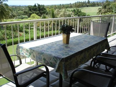 Relax on the large lanai amidst lush greenery and refreshing breeze