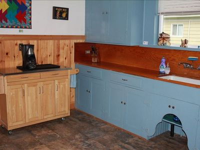 Roomy, original cabinets and counters.