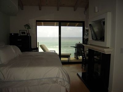Master with fireplace, ocean views; fall asleep to the gentle lapping of waves