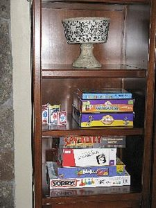 Family night? Board games are in the den cabinet.