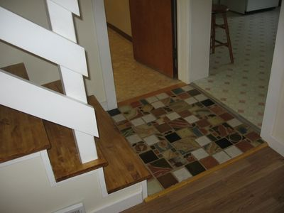 Our hand made tiles serve as the transition from kitchen to living room to bath.