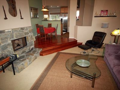 Living room, gas log fireplace, dining step up and kit