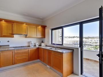 Large kitchen leading to balcony