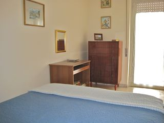 Trastevere area condo photo - A door to the balcony gives a nice view while working at the desk or from bed.