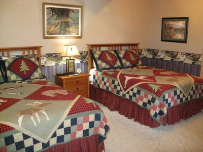 The lower level bedroom boasts two queen size beds. Perfect for the kids/in-laws