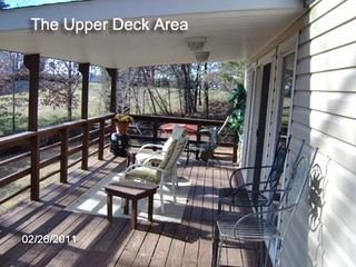 Huddleston property rental photo - Covered deck/sitting area
