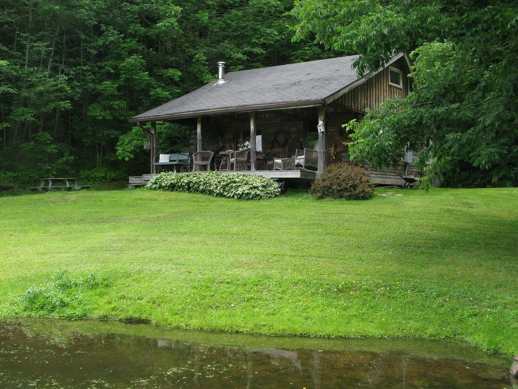 Charming Log Cabin On Private Pond Nestled In VRBO. Full resolution  snapshot, nominally Width 1024 Height 768 pixels, snapshot with #7A9833.