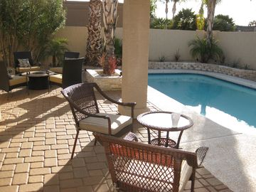 Newly remodeled patio with BBQ, fire pit, 2 Bistro Sets, Fireplace, dining table