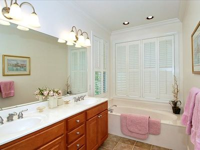Large master bath offers dual vanities and separate tub and walk-in shower