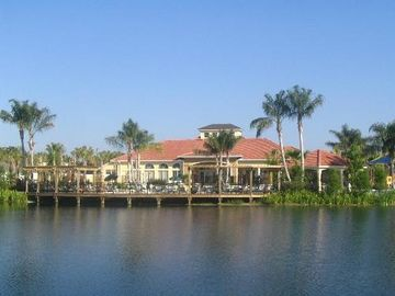 Another view of the beautiful Terra Verde clubhouse and fishing lake.