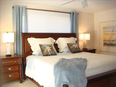 Master Bedroom w/ Flat Screen TV and views of pool and canal
