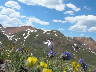 Our friend Sam and the wildflowers above Silverton in June.