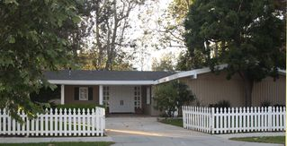 Malibu house photo - Front approach with picket fence.