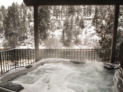 Lower level - 6 person hot tub overlooking the river from the covered patio.