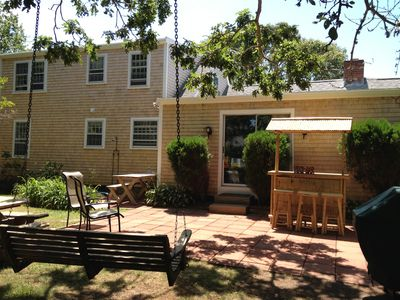 Yarmouth house rental - Outdoor patio features TIKI bar, hammock,swing chair, picnic table and gas grill