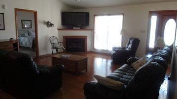 The upstairs living area includes a 50 inch flat screen TV