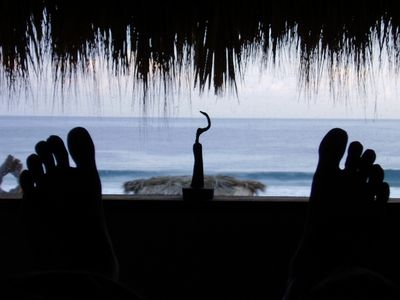 look out to the ocean from the bed